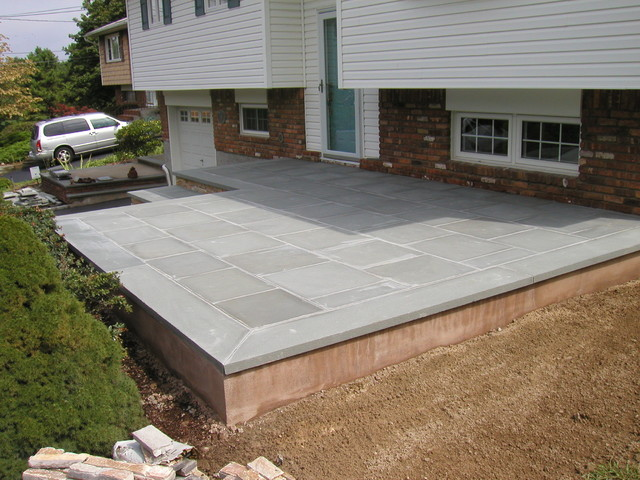 patio large traditional stone patio idea in new york - Front Patio