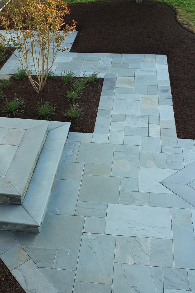 Mid-sized elegant backyard stone patio kitchen photo in New York