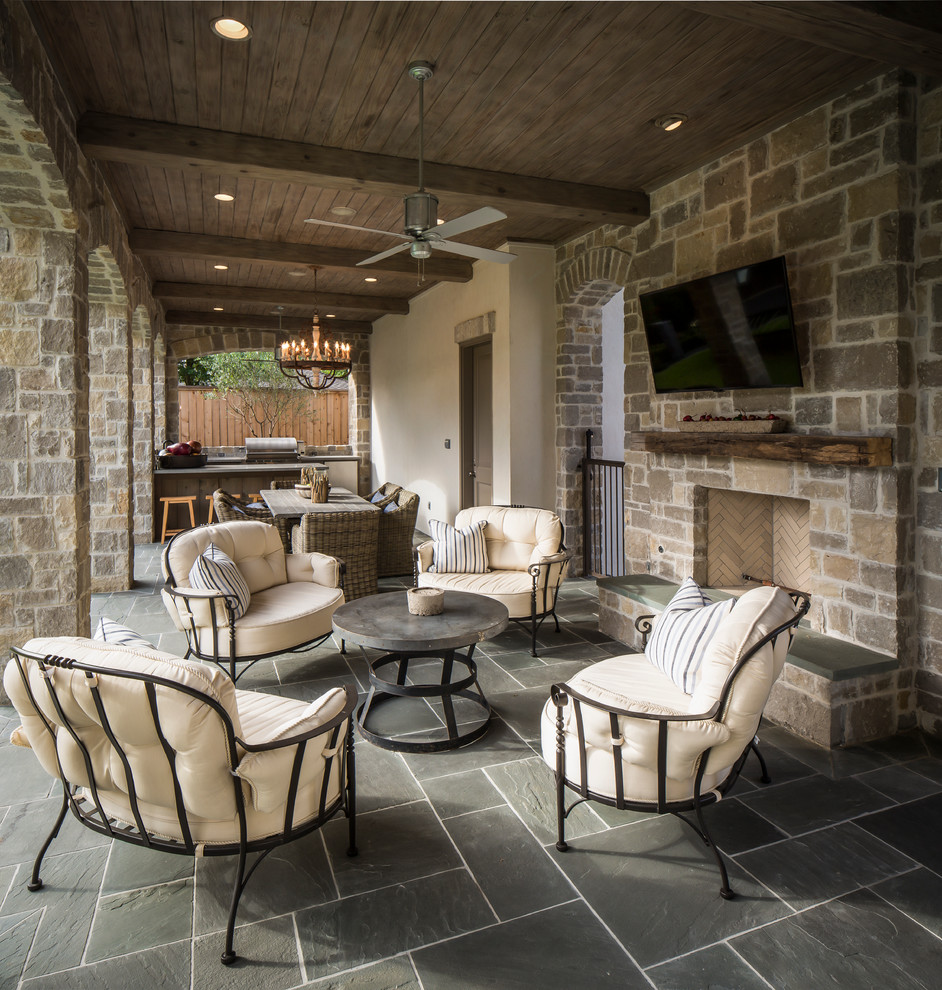 Elegant patio photo in Houston with a fire pit and a roof extension