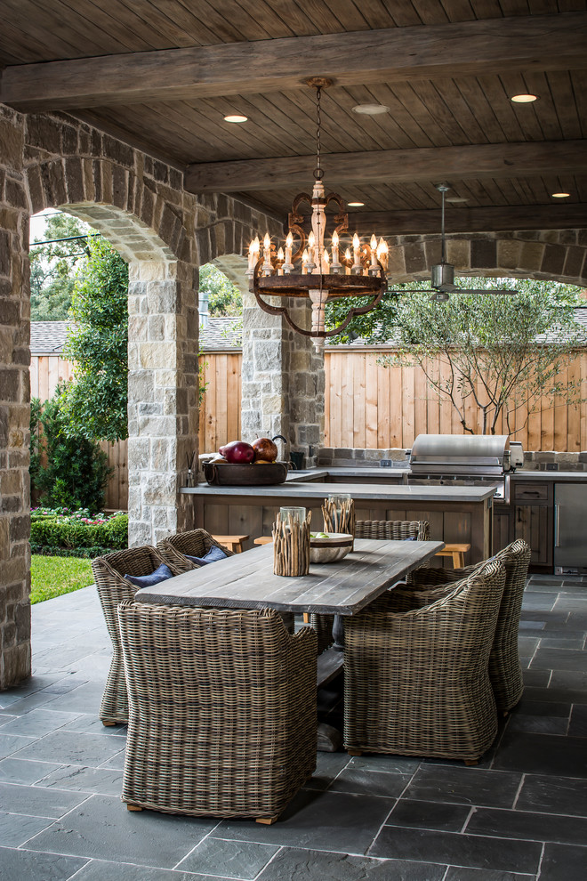 Example of a classic patio kitchen design in Houston