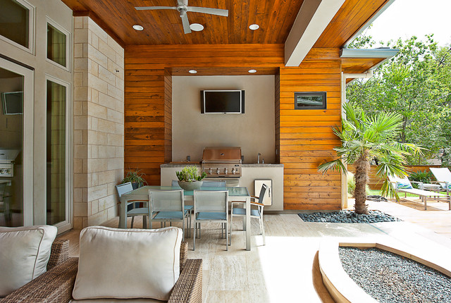 inspiration for a contemporary patio kitchen remodel in austin with a roof extension - Patio Living