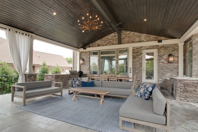Example of a large 1960s backyard concrete patio kitchen design in Nashville with a roof extension