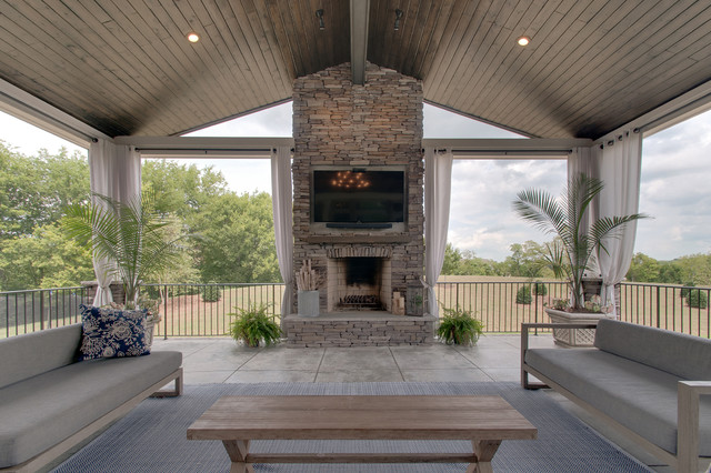 Inspiration for a large midcentury modern backyard concrete patio kitchen remodel in Nashville with a roof extension