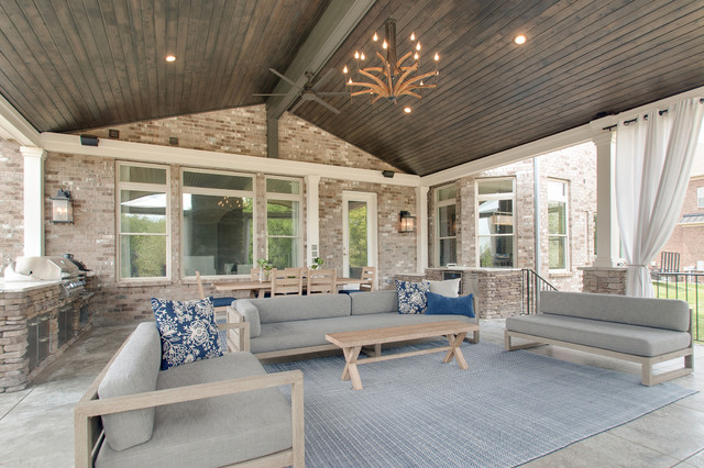 Inspiration for a large 1960s backyard concrete patio kitchen remodel in Nashville with a roof extension