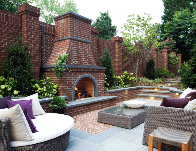 Brick fireplace with flagstone accents traditional patio for Brick garden room designs