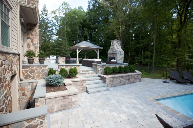 Brick paver pool deck outdoor fireplace and kitchen on for Fireplace on raised deck