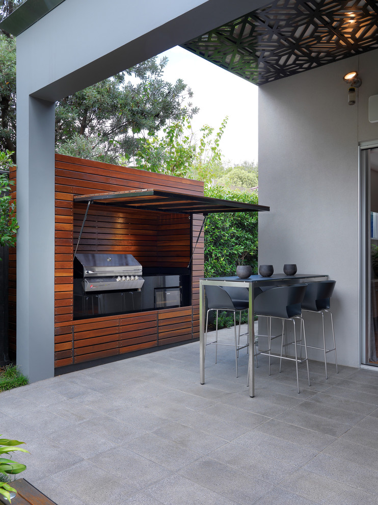 Large trendy backyard tile patio photo in Melbourne with a roof extension