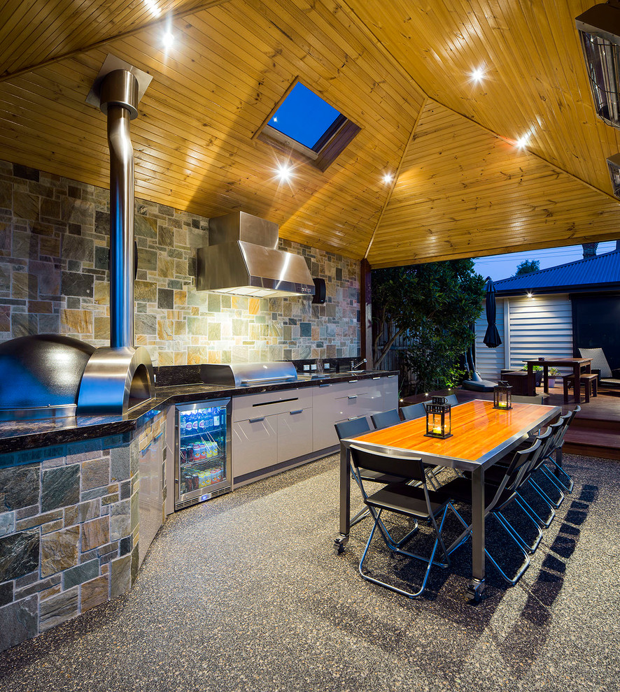 Example of a trendy patio kitchen design in Melbourne with a roof extension