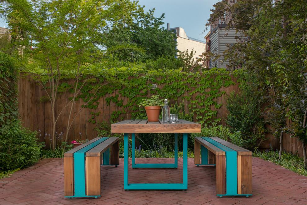 Trendy brick patio photo in Portland