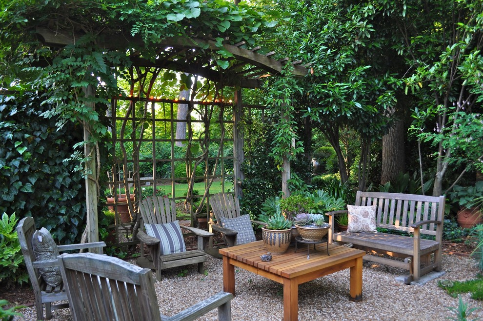 Example of a classic gravel patio design in Charlotte with no cover