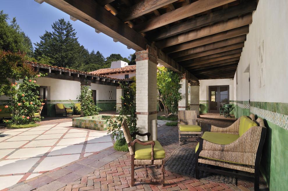 Patio - southwestern courtyard patio idea in San Francisco