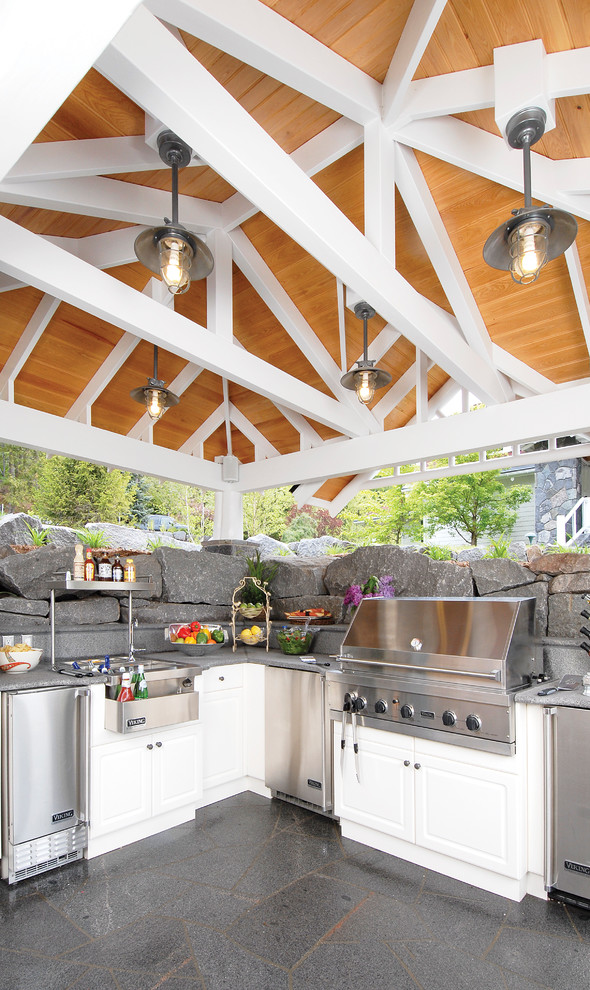 Patio kitchen - mid-sized traditional backyard stone patio kitchen idea in Other with a gazebo