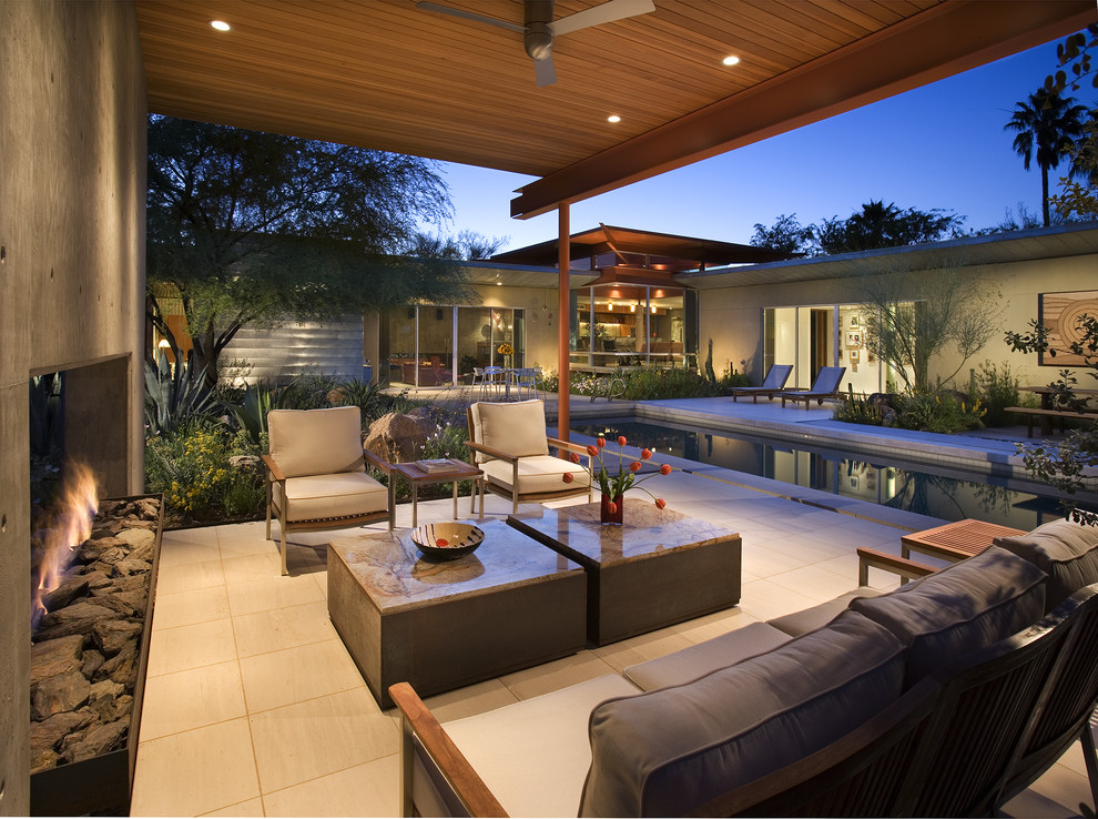 Trendy courtyard patio photo in Phoenix with a fire pit
