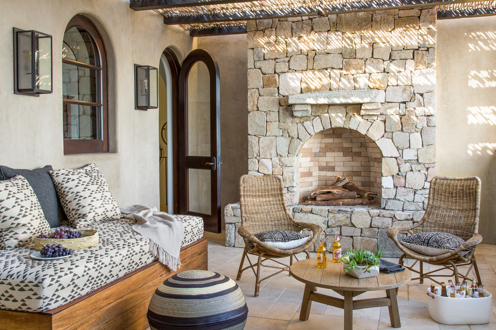 Patio - mediterranean patio idea in San Francisco with a pergola and a fireplace