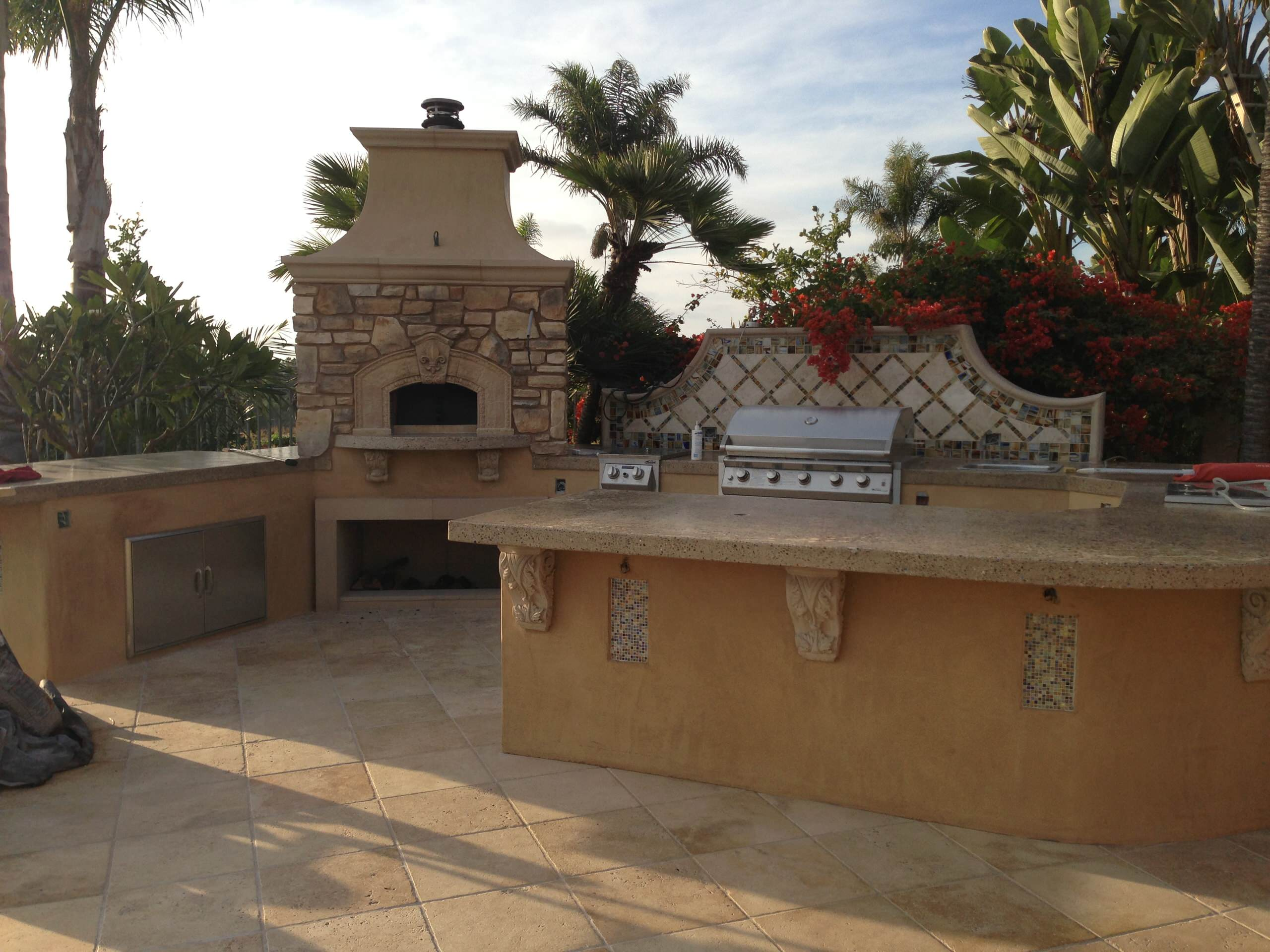 Outdoor Kitchen Island and Tiled Backdrop