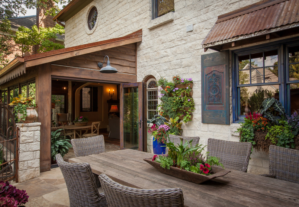 Inspiration for a rustic patio remodel in Dallas with no cover