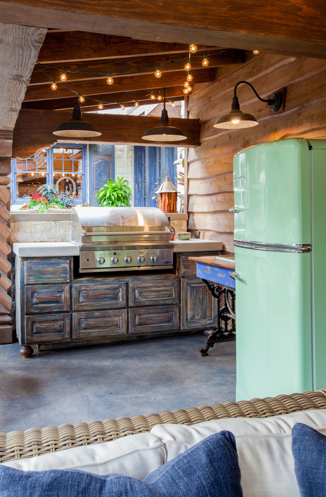 Example of a mountain style patio kitchen design in Dallas with a gazebo