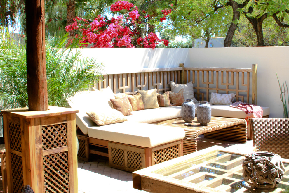 Example of a mid-sized eclectic courtyard brick patio design in Phoenix