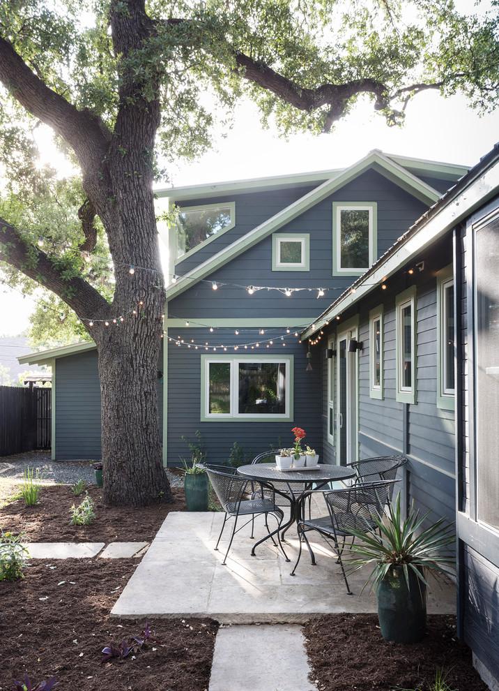 Patio - mid-sized contemporary backyard stone patio idea in Austin