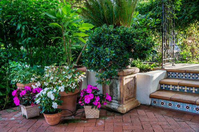 example of a large tuscan backyard brick patio design in san francisco - California Garden