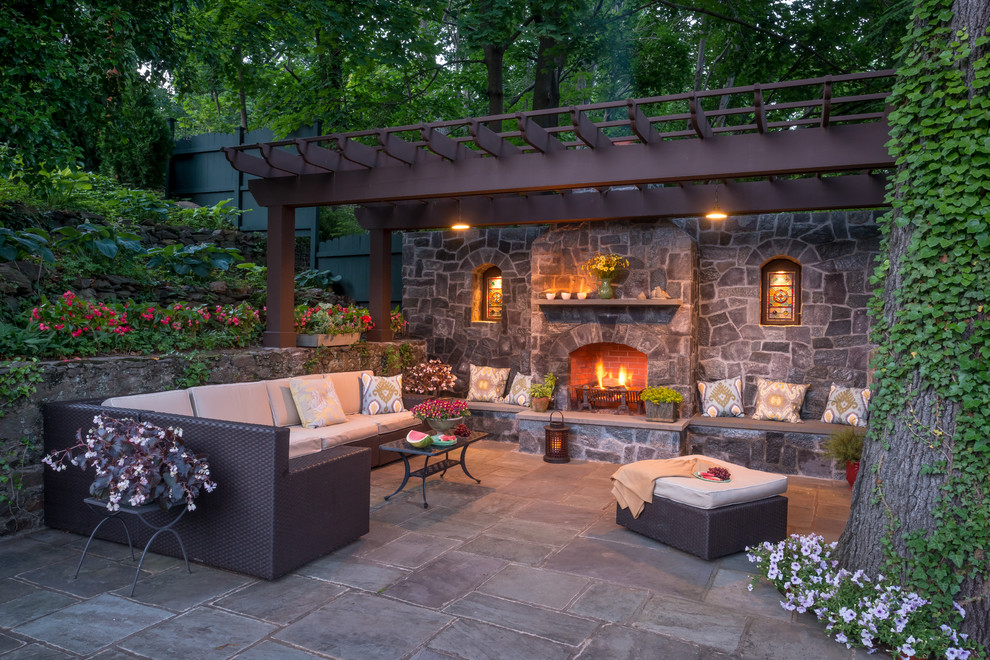 Patio - huge traditional patio idea in New York with a fire pit