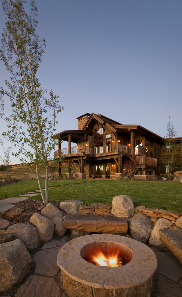Inspiration for a timeless patio remodel in Denver with a fire pit