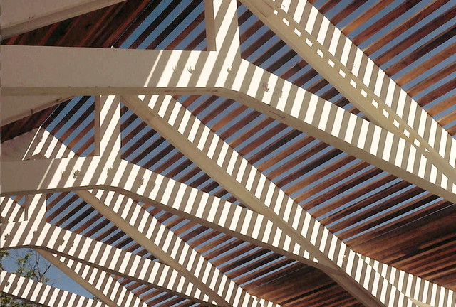 Cedar 2x2's cast geometric shadows. traditional-patio