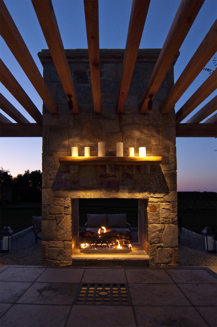 Cedar pergola built into outdoor fireplace traditional patio