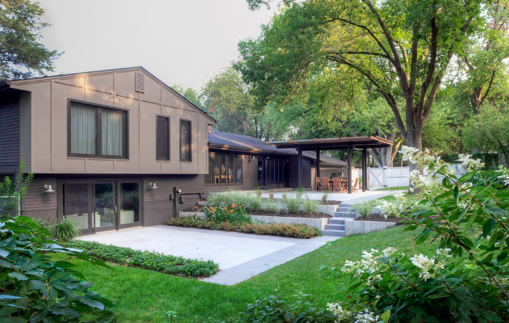 Example of a trendy backyard patio design in Omaha