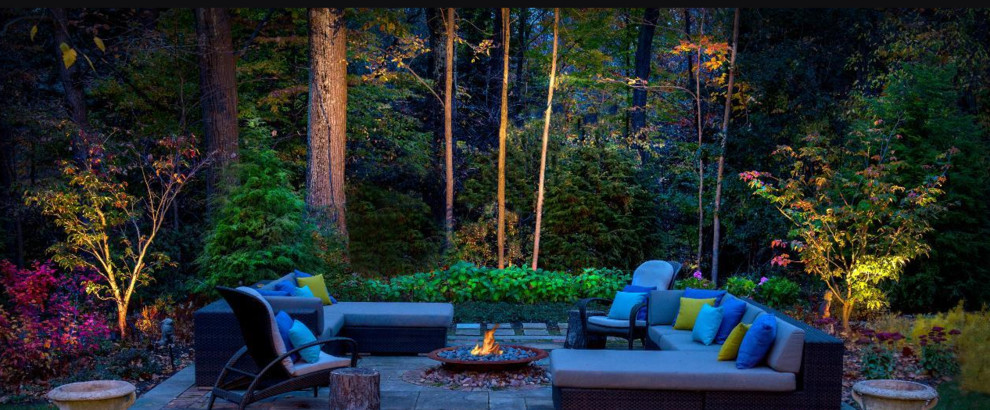 Inspiration for a mid-sized transitional backyard stone patio remodel in Other with a fire pit and no cover