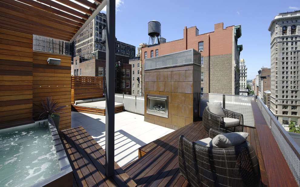 Inspiration for a huge contemporary patio remodel in New York with a fire pit