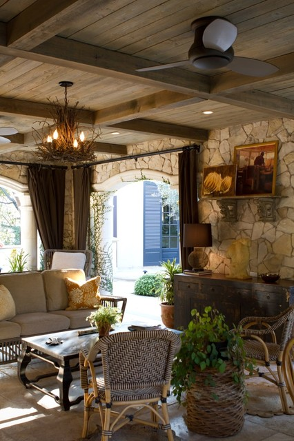 Inspiration for a rustic patio remodel in Los Angeles with a roof extension