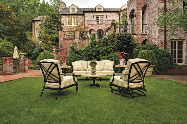 Chat group with mosaic table and outdoor lounge chairs in cast aluminum traditional-patio