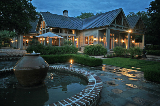 Circular fountain is feature of outdoor entertaining area. traditional-patio