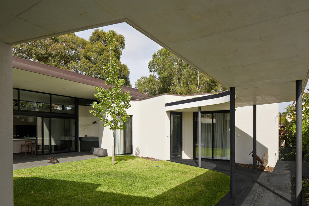 This is an example of a contemporary patio in Perth.