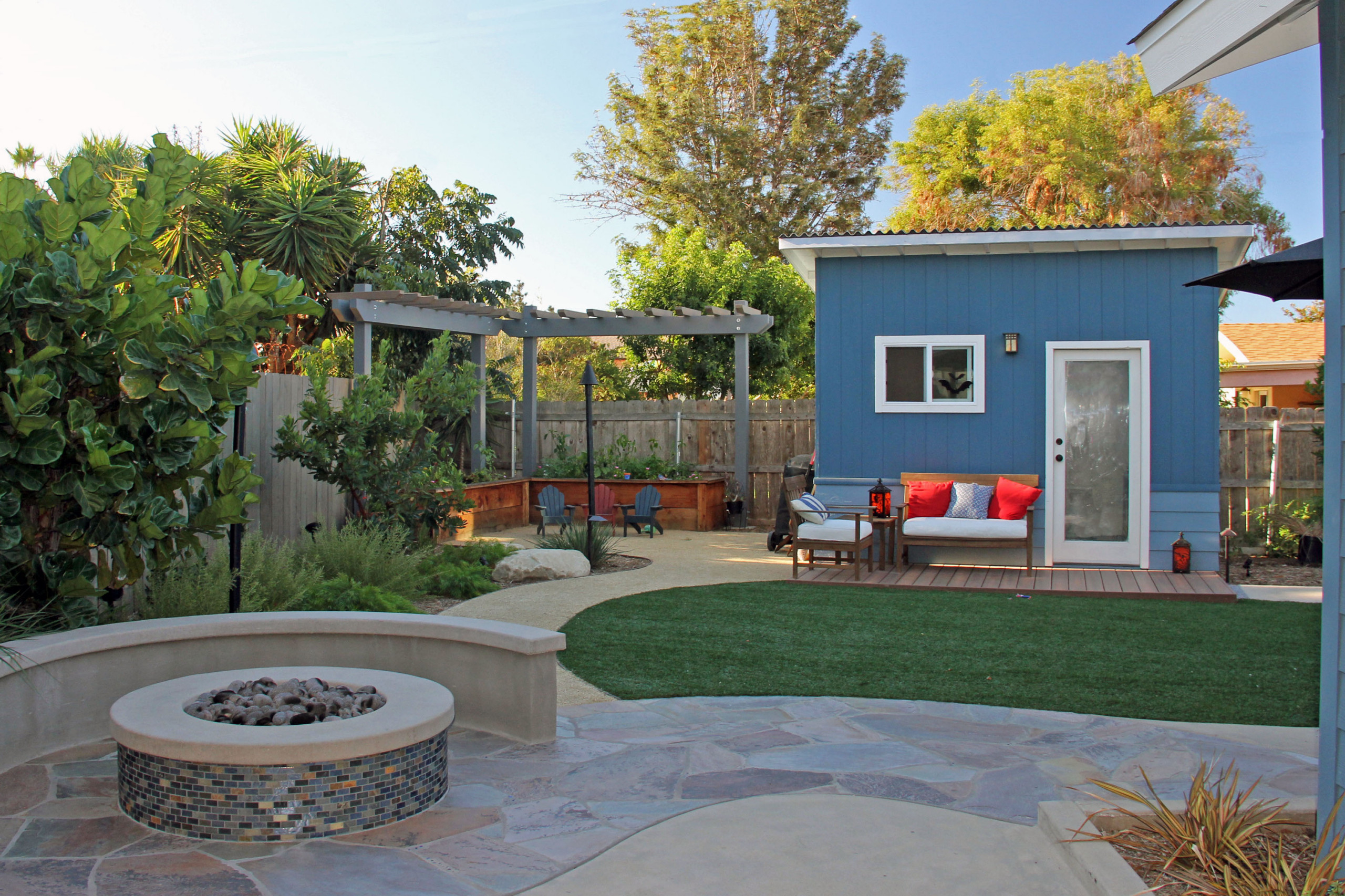 Fire Pit Among Turf, ADU, and Vegetable Garden