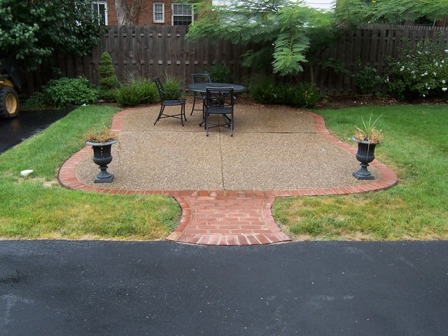Clayton Missouri Exposed Aggregate Patio With Brick Masonry Border And Walkway