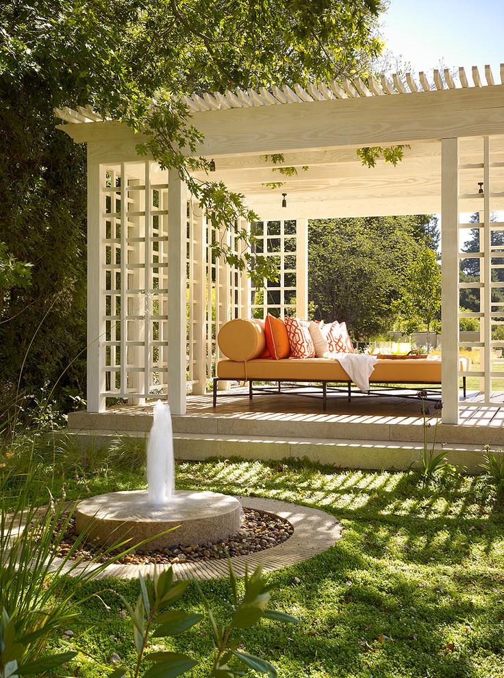 Elegant stone patio photo in Houston with a gazebo