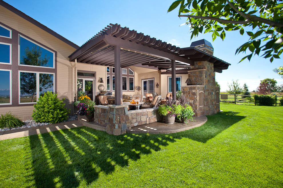 Inspiration for a timeless patio remodel in Denver with a fire pit and a pergola