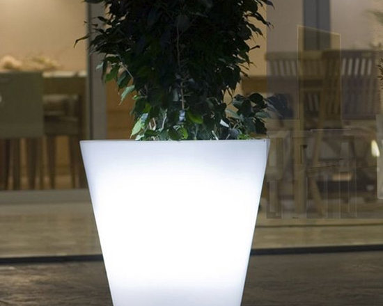 Cone Illuminated Outdoor Planter - This illuminated outdoor planter is available with LED lighting in multiple colors or a style with a fluorescent bulb that displays only white light.