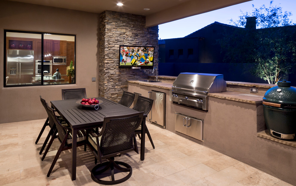Trendy patio photo in Phoenix with a roof extension