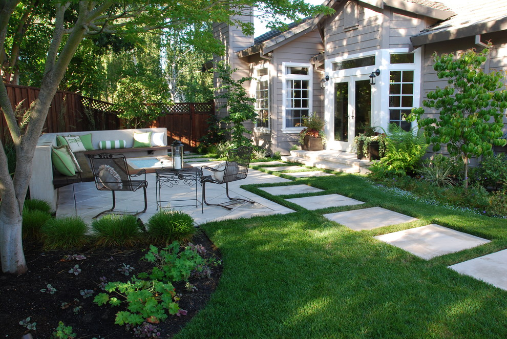 Inspiration for a mid-sized timeless backyard concrete paver patio remodel in San Francisco with a fire pit