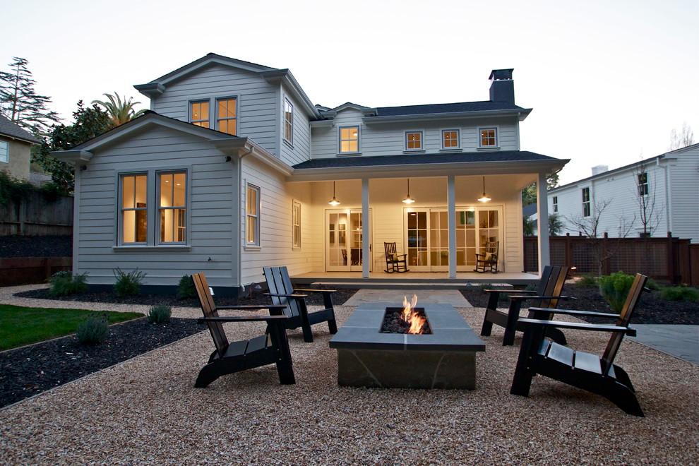 Patio - farmhouse backyard patio idea in San Francisco with a fire pit
