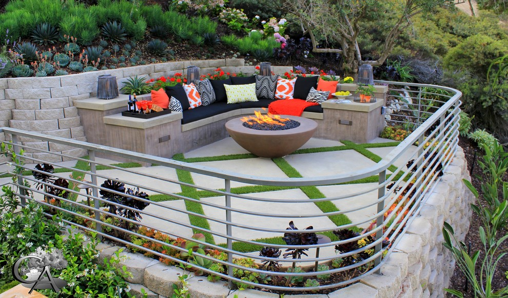 Patio - contemporary patio idea in Orange County with a fire pit