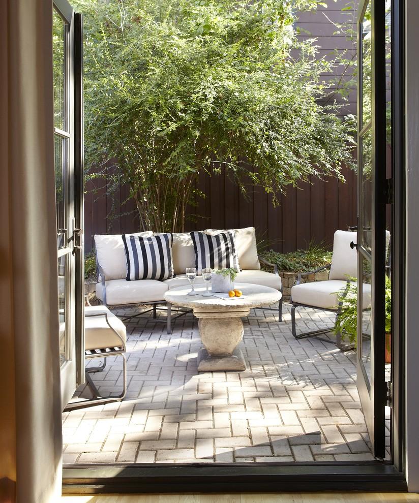 Patio - contemporary concrete paver patio idea in Dallas