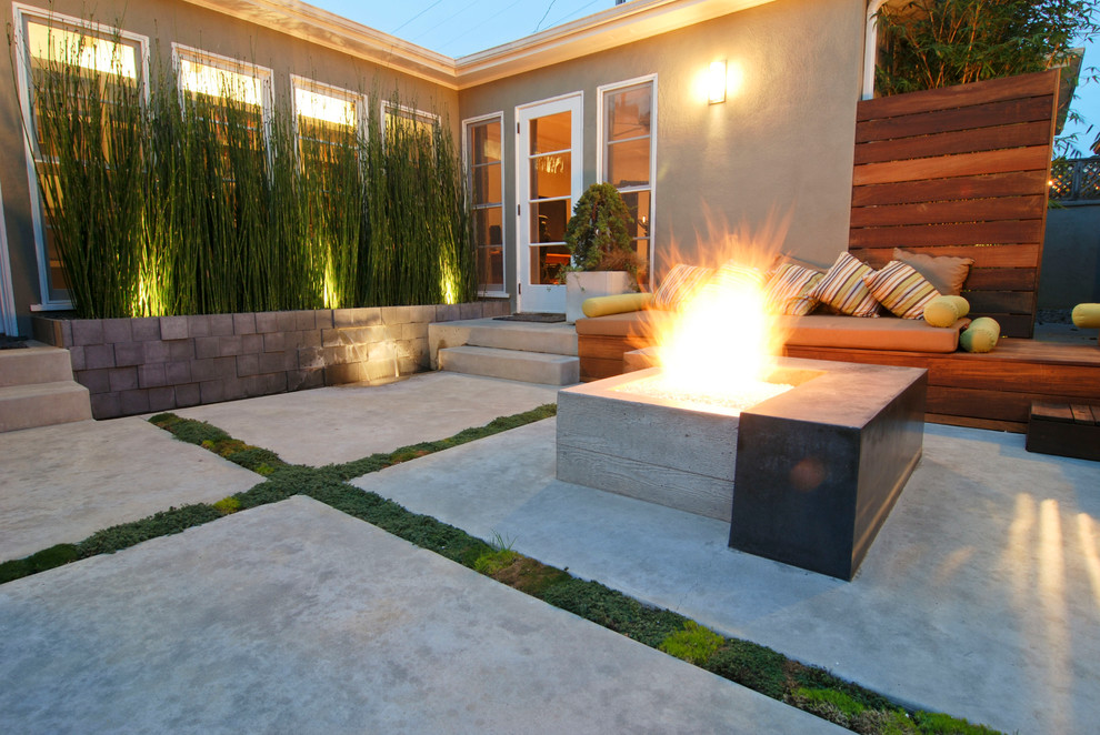 Inspiration for a contemporary concrete patio remodel in San Diego with a fire pit and no cover