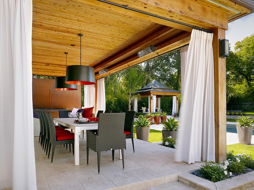Patio - contemporary patio idea in London with a pergola