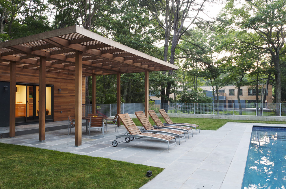 Example of a trendy patio design in New York with a pergola