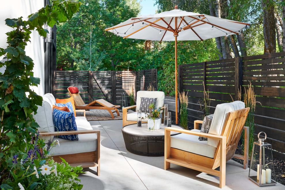 Patio - mid-sized contemporary backyard concrete paver patio idea in Denver with no cover