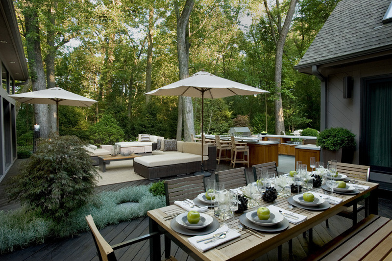 Inspiration for a large contemporary backyard tile patio kitchen remodel in Chicago with no cover